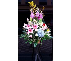 BK2 LARGE OPENING BASKET WITH LILIES & BLUE HYDRANGEAS