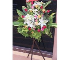 BK20 MIXED COLOUR ROSES WITH WHITE LILIES GRAND OPENING BASKET