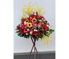 BK23 LARGE OPENING BASKET WITH RED GERBERAS/ SUNFLOWERS / DANCING ORCHIDS / MATCHING GREENS