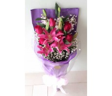 F43 TIGER LILIES WITH 6 RED ROSES BOUQUET