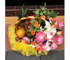 H2 ASSORTED FRUITS WITH PINK GERBERAS AND GREENERIES
